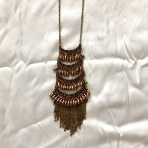Long gold and tassel chain necklace